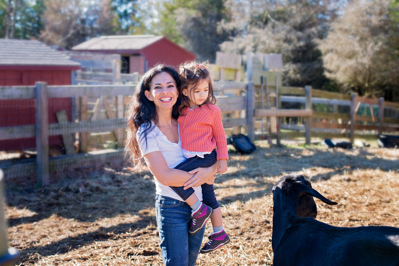 Mom and baby petting rescued Cow Amy at For the Animals Sanctuary, Blairstown, NJ. Compassionate living. Family Photographer Pamira Bezmen Photography.